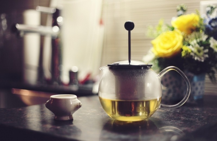 teapot-and-flowers-on-table-foter